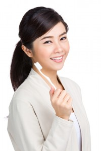 young woman holding a toothbrush